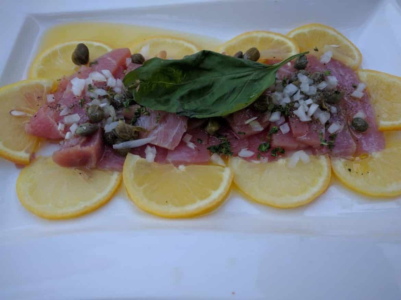 Ahi tuna on top of lemon, as seen in hotel restaurant in Tecate