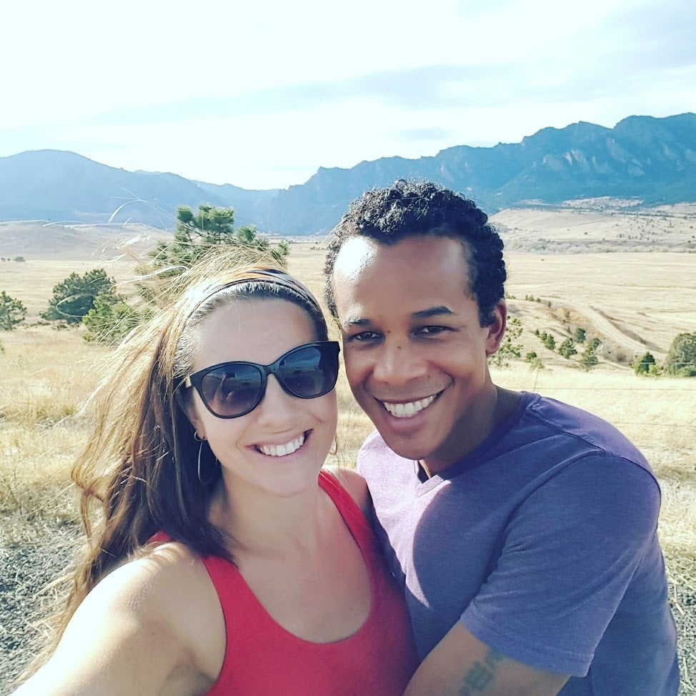 couple posing in Red Rock Denver near the amphitheater