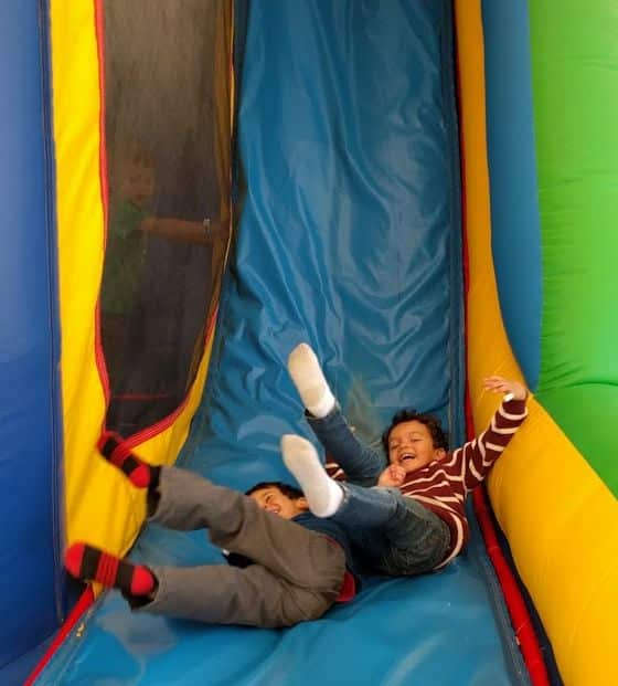 Kids having fun on bounce house slide at Young Jersey's Dairy in Springfield, Ohio