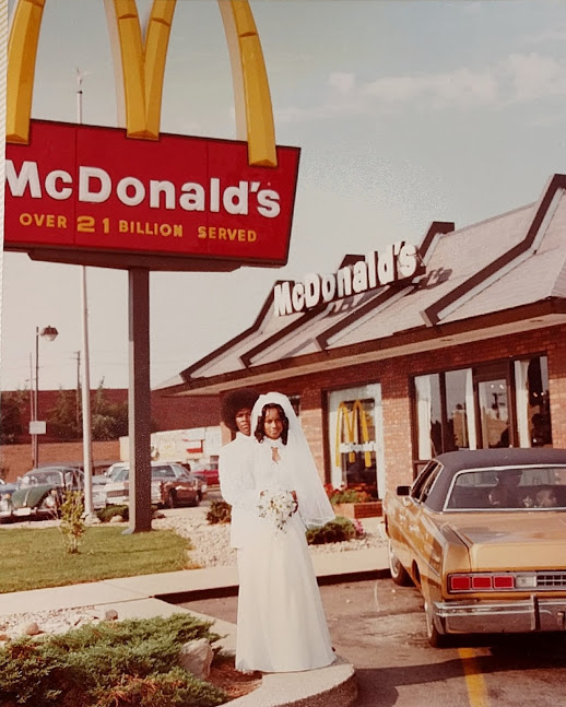 Couple standing outside of the McDonald's they were married in