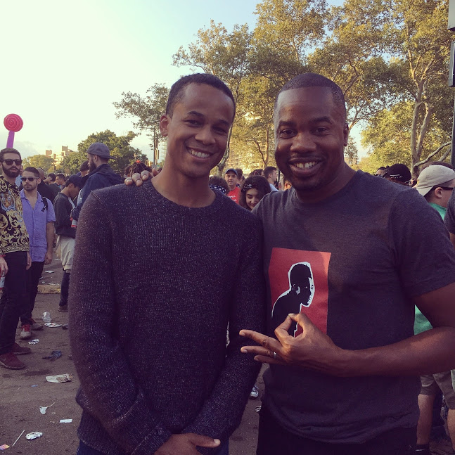 Two black men at posing at Jay Z's Made In America Festival