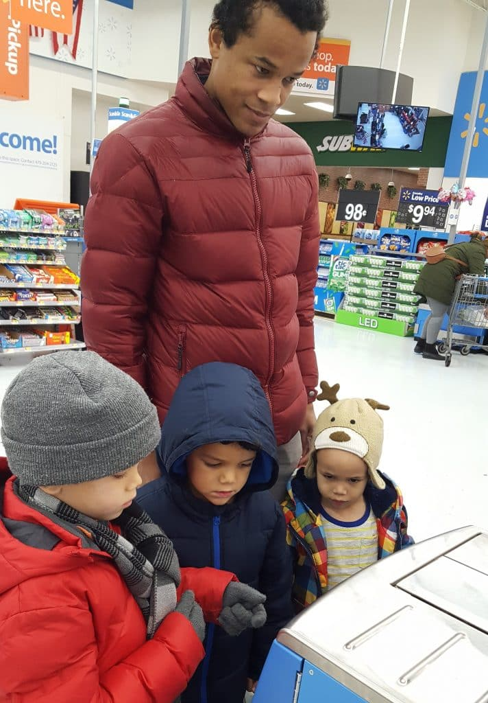 father at Walmart self-checkout with three kids before deciding to boycott the store