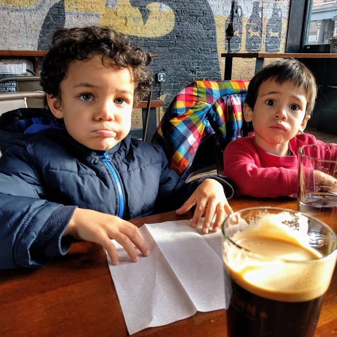 Kids look bored watching parents drink beer