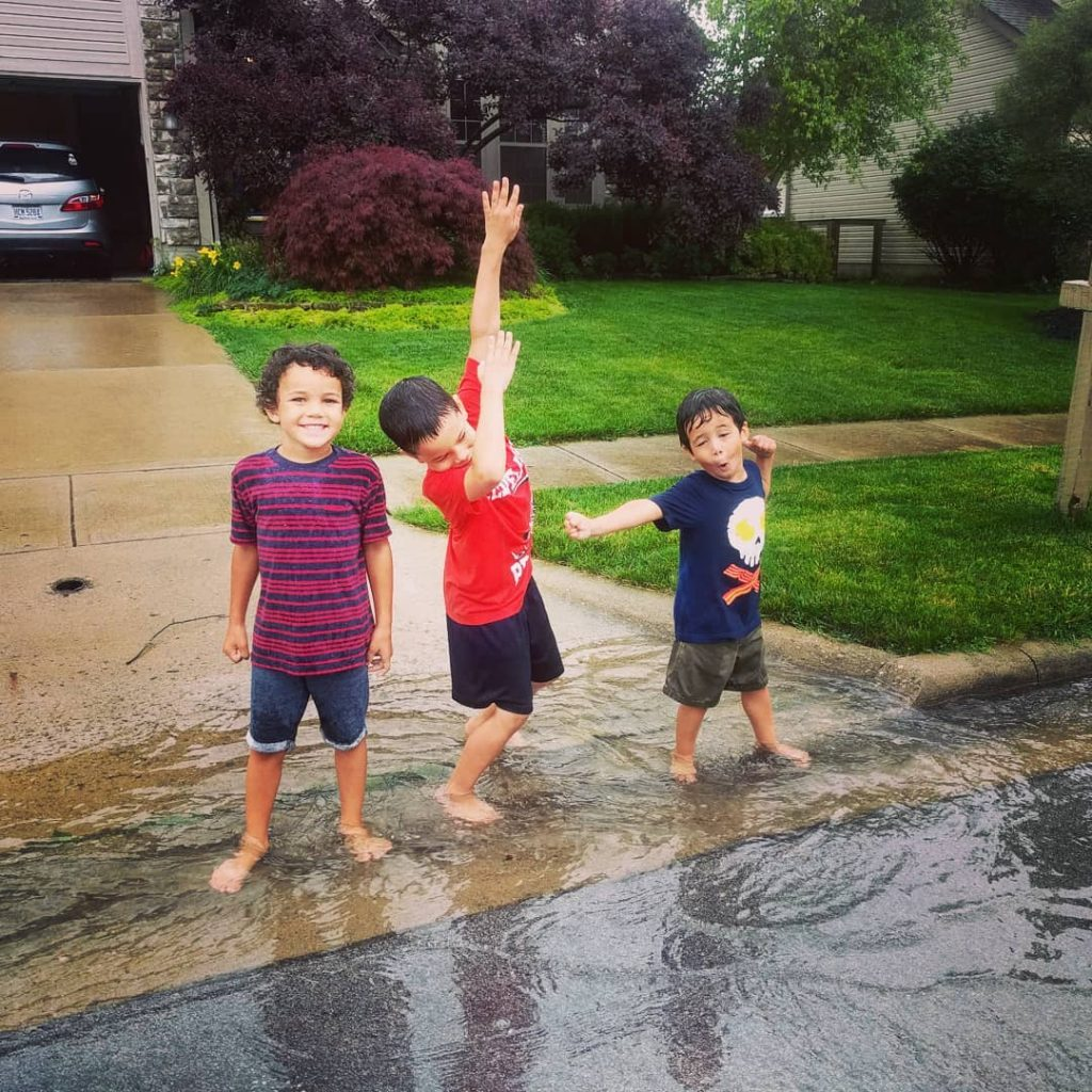 kids playing in the rain