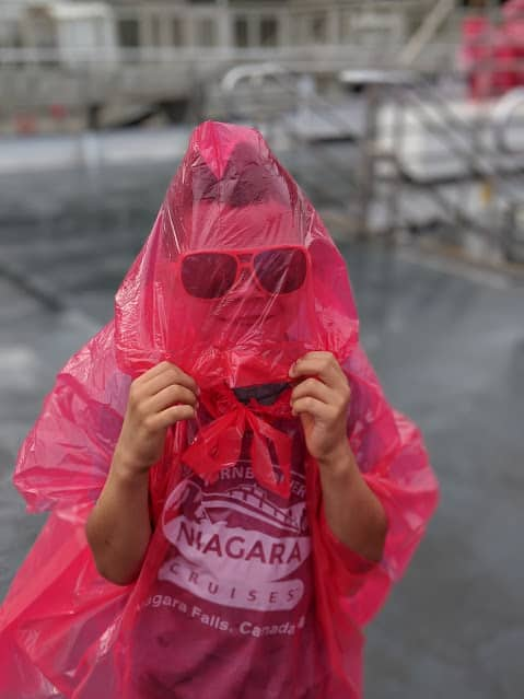 kid wearing poncho for niagara falls hornblower cruise