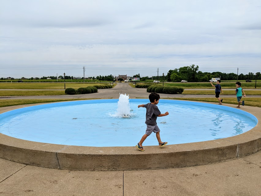 kids running around fountain at chateau des charmes
