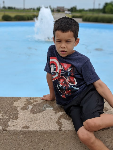 kid after falling in fountain at chateau des charmes