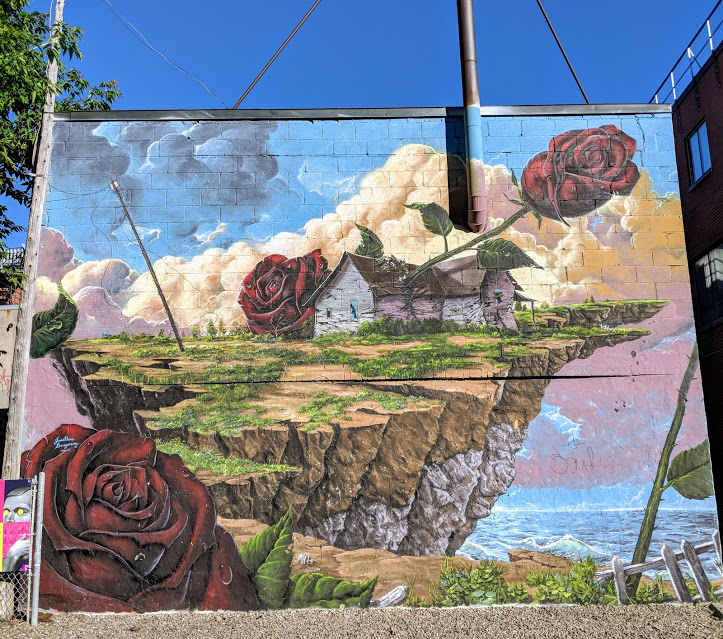 Mural of rose growing through house as seen on Boulevard Saint Laurent in Montreal