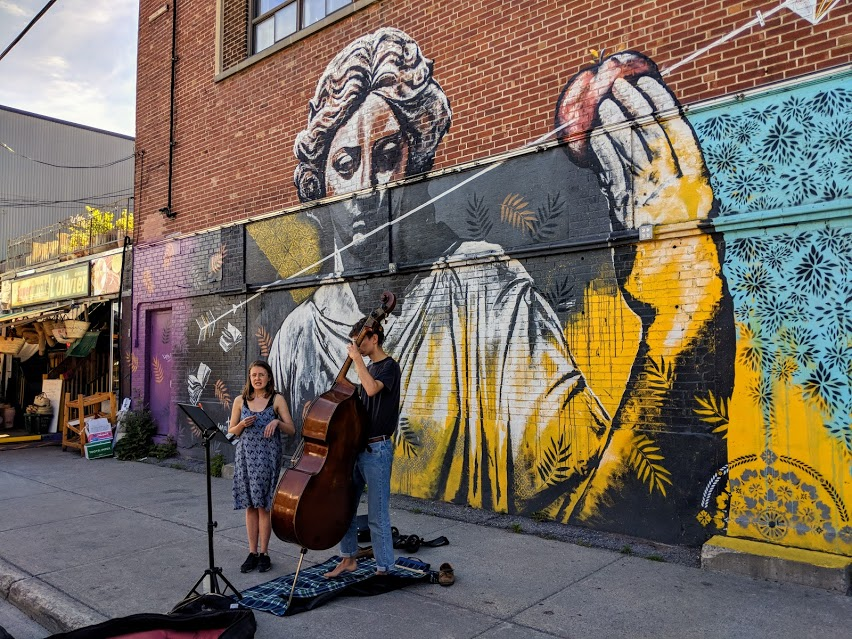 Two street performers with cello outside of  Jean-Talon Market in Montreal