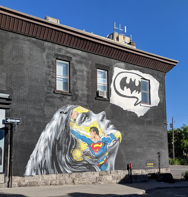 street art superman and batman montreal