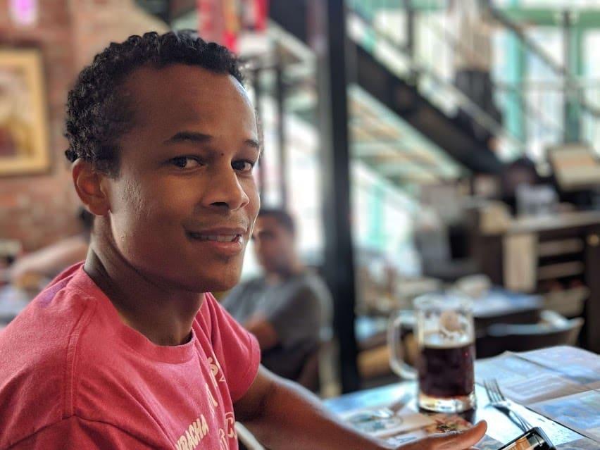 black man in bar with beer portrait mode pixel 2
