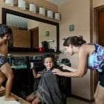 Biracial kids getting haircuts from Mom