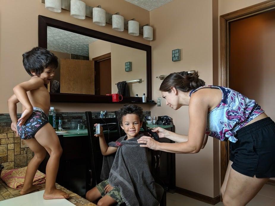 biracial kids getting haircut at home