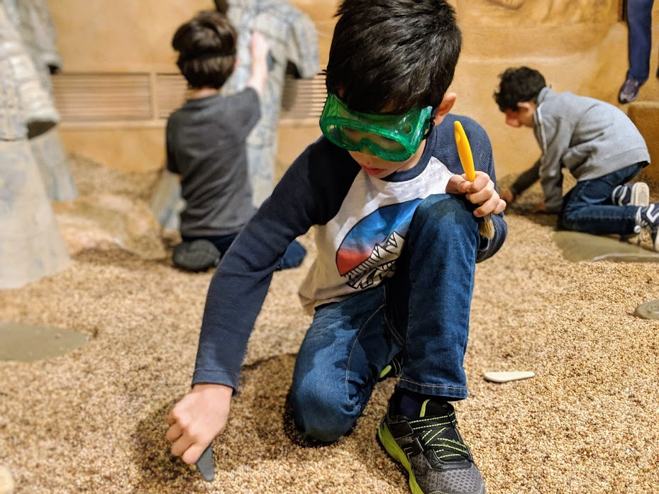 kids digging for terra-cotta warrior replicas in Children's Museum of Indianapolis