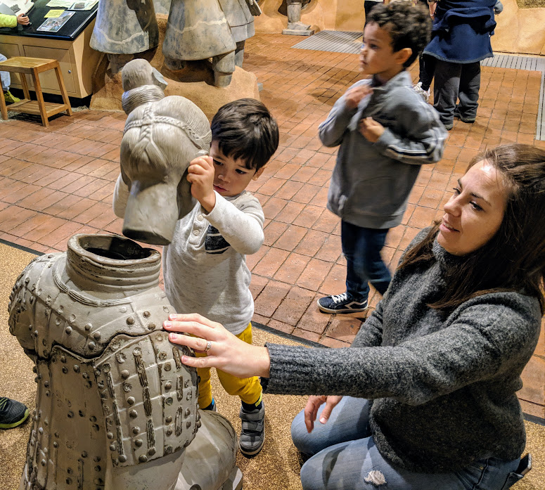 Kids reassembling replicas of terra cotta warriors at the Children's Museum of Indianapolis