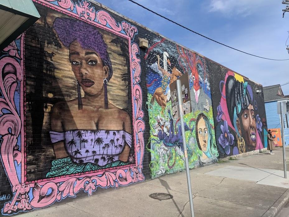long wall of street art in New Orleans Marigny neighborhood