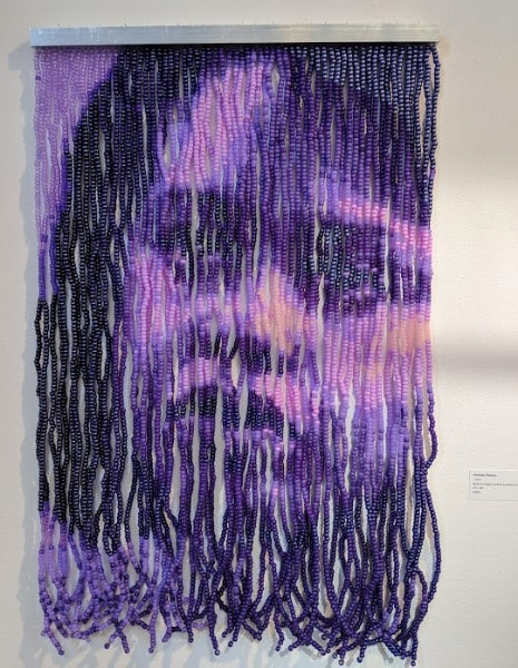 Beaded purple artwork by Felandus Thames, seen at PRIZM Art Fair in Miami.