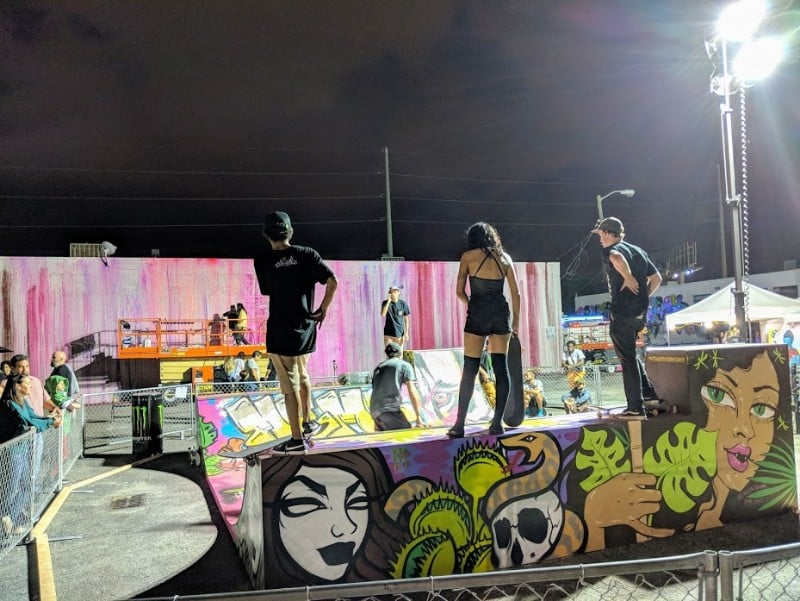 Woman wearing thigh highs skateboarding at Basel House in Miami.