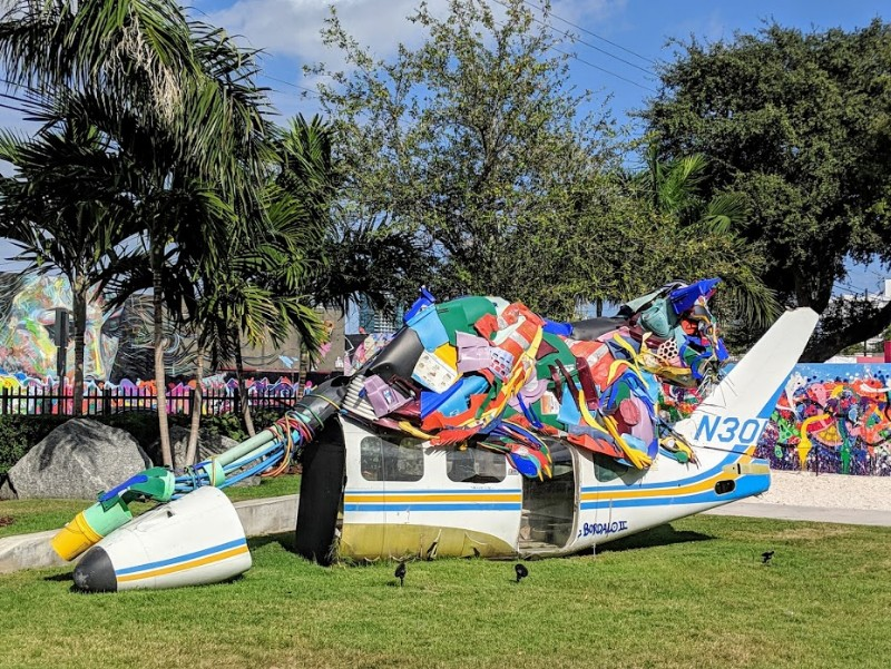 Wynwood Miami sculpture of large cat resting on jet