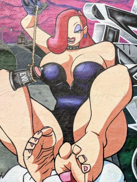 Street art mural of voluptuous woman.