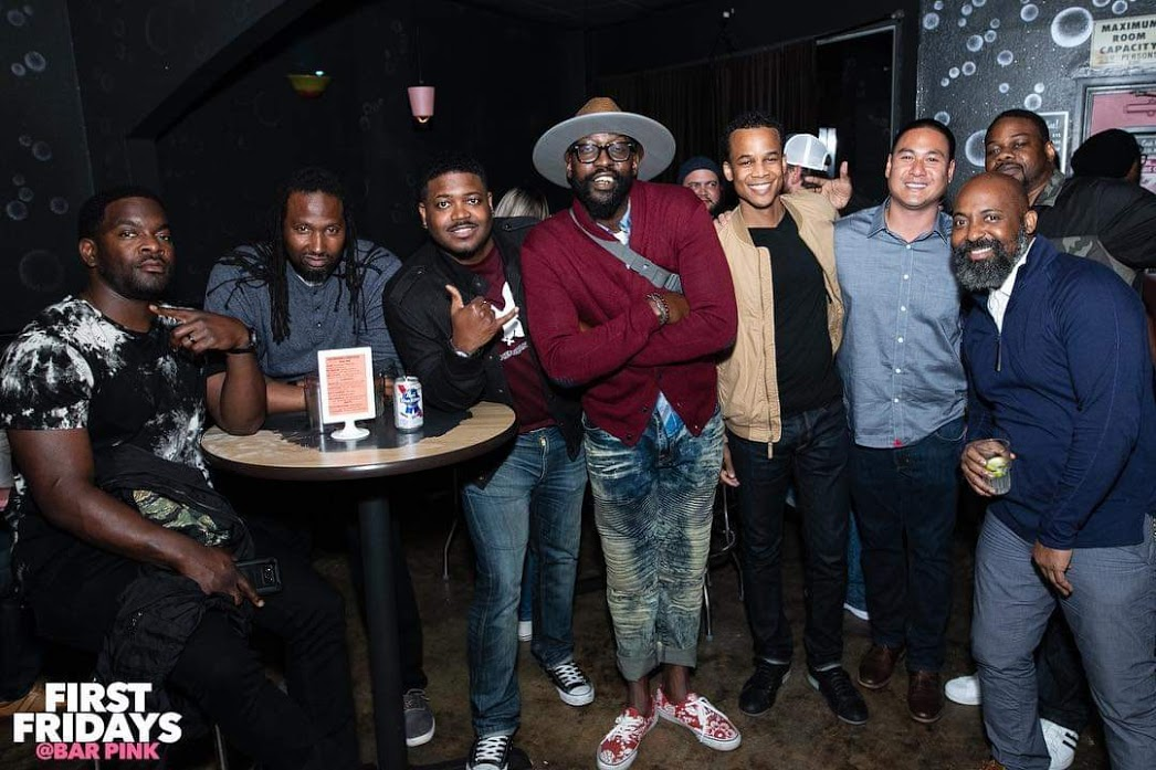 Eight men posing for picture in dive bar (Bar Pink in San Diego for First Fridays).