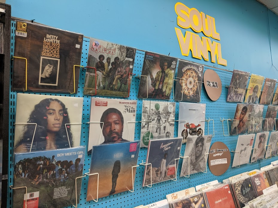 Album cover hanging on wall at Vintage Vinyl store in St. Louis