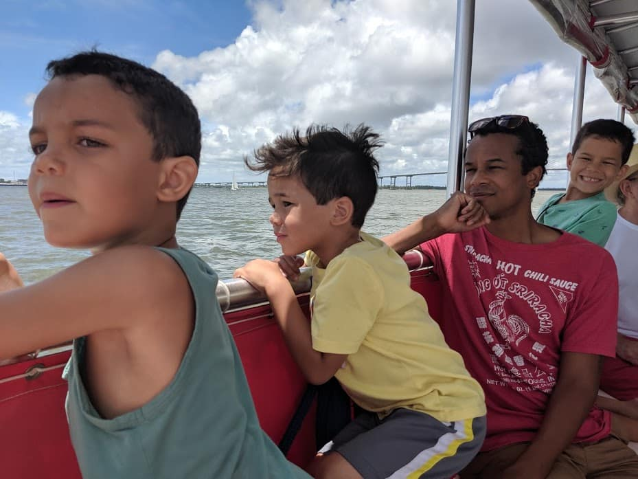 Dad and kids riding the Charleston Water Taxi.