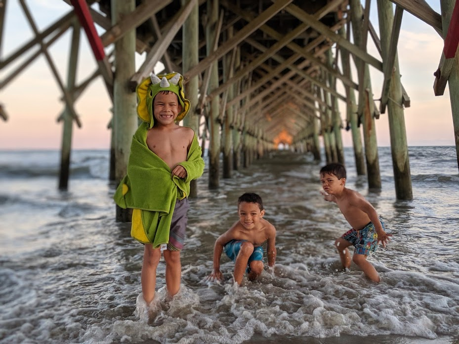 Kids under pier at Folly Beach in South Carolina.