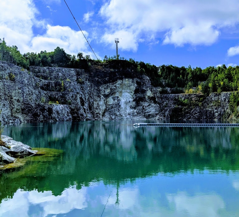 Green water in Morrison's Quarry in Ottawa.
