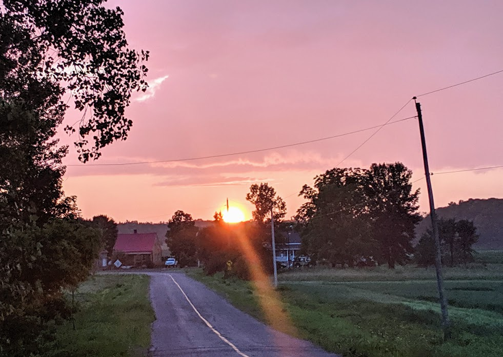 Sunset by a farm house in Beaconcour, Quebec.