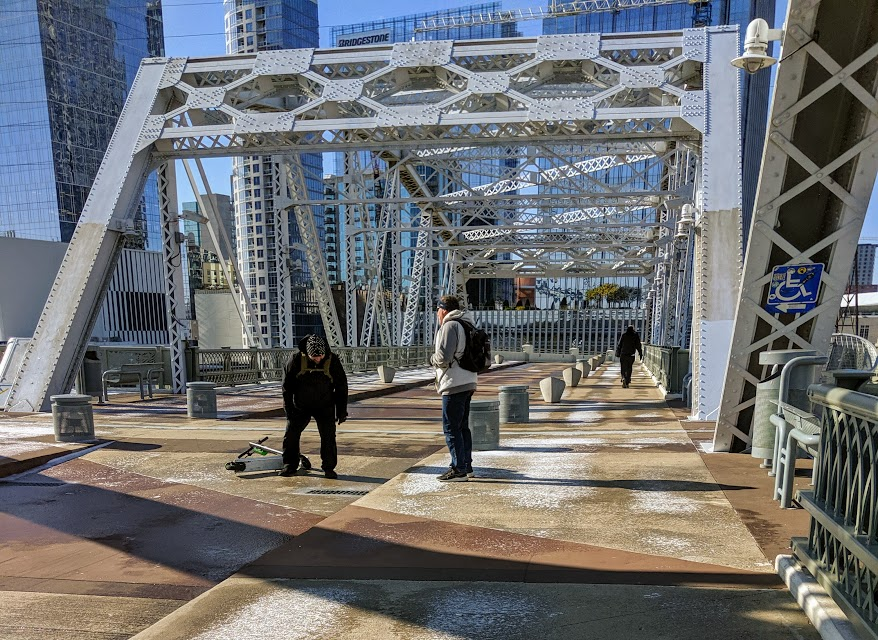 Man falling off scooter on icy John Seigenthaler Pedestrian Bridge