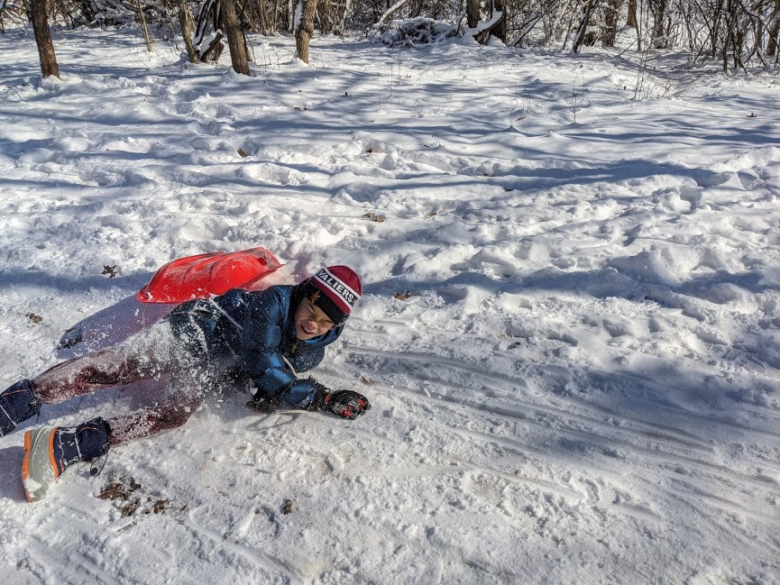 Kid falling off sled at Simsbury Disc Golf Course in Pickerington, Ohio