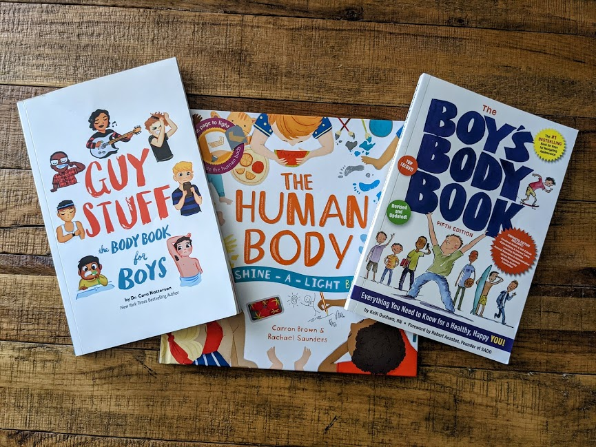Image of three books for growing boys: Guy Stuff, The Human Body, and The Boy's Body Book.